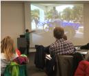 Referent Christian Magiera erklärt das Startprozedere beim Zeitfahren der Handbiker